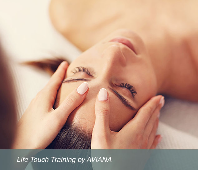 woman massaging another woman's head during life touch training